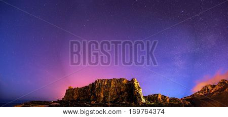 The starry sky above rocky mountain, astrophoto