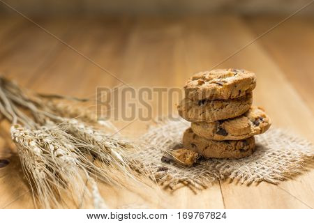 Chocolate Cookies On A Cloth Sack On Wood.