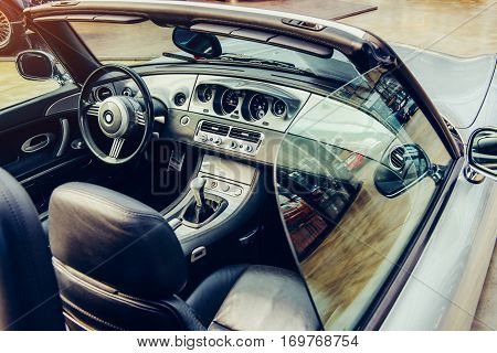luxury car interior, leather steering wheel front seats and dashboard panel