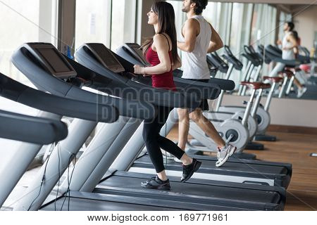 People training on a treadmill
