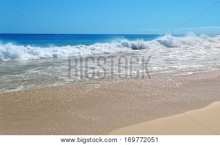 Sea waves background with sand and foam ocean water panoramic view