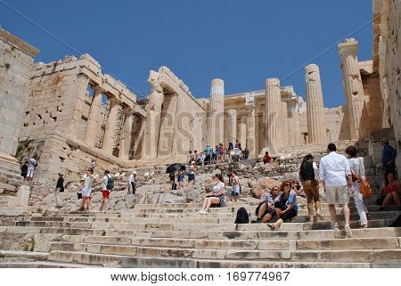 ATHENS, GREECE - MAY 13, 2016: Tourists on the entrance steps to the historic Acropolis of Athens. Dating from the fifth century BC, the site is one of the top tourist attractions in the World.