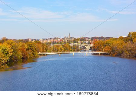 Autumn colors in Georgetown Washington DC. A view on Georgetown University from Roosevelt Bridge over Potomac River.