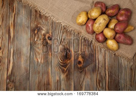 Potatoes On A Rustic Background