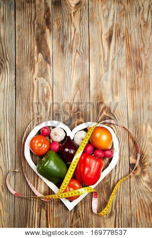 Sport And Diet. Vegetables, Centimeter. Peppers, Tomatoes, Garlic, Onions,  Radishes In The Heart On
