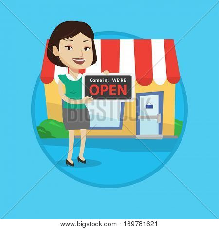 Shop owner holding open signboard. Cheerful shop owner standing with open signboard. Woman inviting to come in her open shop. Vector flat design illustration in the circle isolated on background.