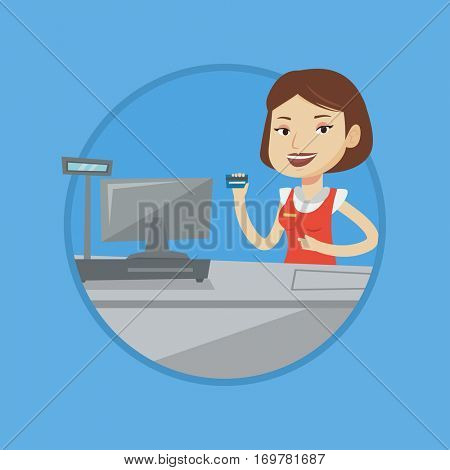 Caucasian cashier holding credit card at the checkout in supermarket. Cashier working at checkout. Cashier pointing at credit card. Vector flat design illustration in the circle isolated on background