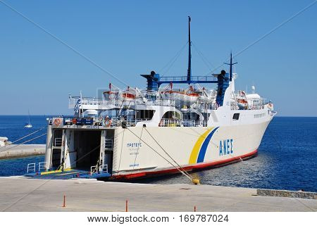 ALONISSOS, GREECE - JUNE 23, 2013: ANES Lines ferry boat Proteus docks at Patitiri harbour on the Greek island of Alonissos. The 87.91mtr vessel was built in 1973 in Greece.