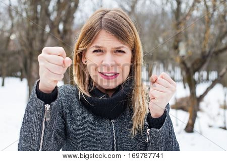 Picture of an extremely mad woman fighting outdoor