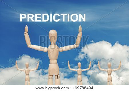 Wooden dummy puppet on sky background with word PREDICTION. Abstract conceptual image