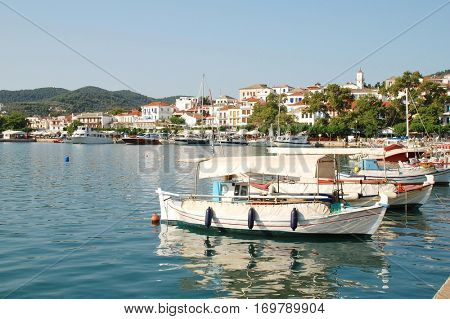 SKOPELOS, GREECE - June 24, 2013: Small boats moored in the harbour at Skopelos Town on the Greek island of Skopelos. The island was one of the main locations for the 2008 film Mamma Mia.