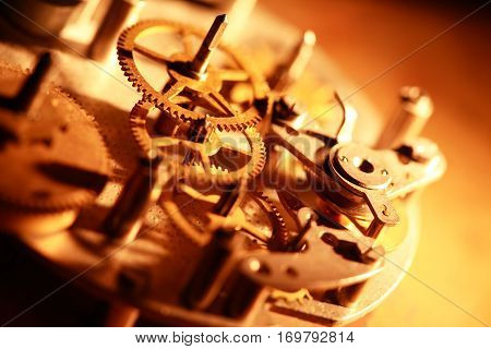 Machinery concept. Gears connection in old clock mechanism