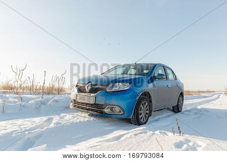 Gomel, Belarus - February 8, 2017: Renault Logan in the winter country road