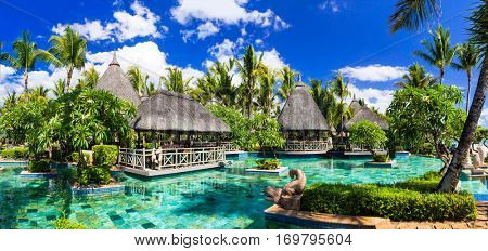 Tropical vacations. Swimming pool and lounge bar in Mauritius island