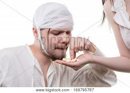 Sick man and analgetic drugs on white background