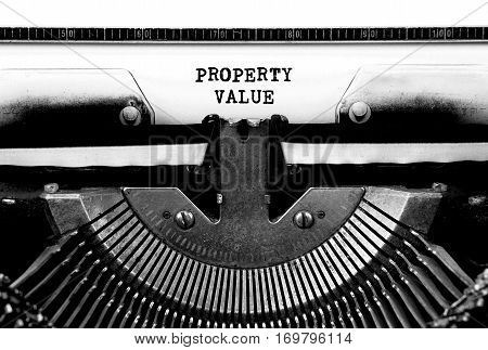 PROPERTY VALUE Typed Words On a Vintage Typewriter Conceptual