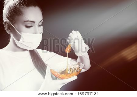 Woman With Sugar Hair Removing Paste On Black Background