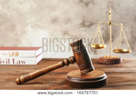 Court gavel on wooden table, closeup