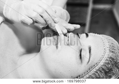 Depilation With Hot Wax Mustache In The Beauty Salon. Young Woman Receiving Facial Epilation Close U