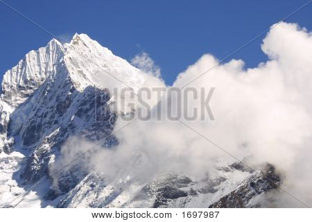 white mountain peak in clouds nepal himalaya. poster