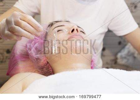 Woman In Spa Salon Receive Skin Treatment. Creating Occlusion For Better Atomization Of The Upper La