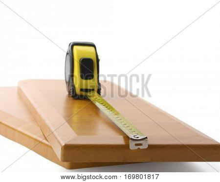 Wooden board and tools on a white background
