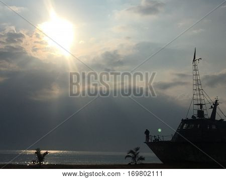 Naval ship at the harbor in the evevning.