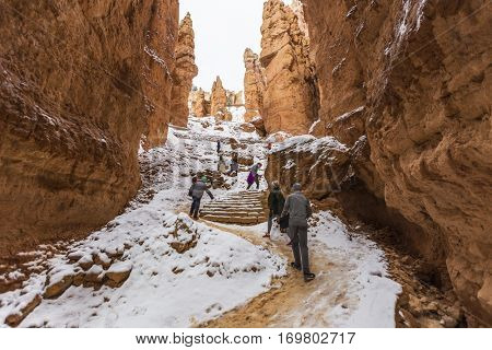Bryce Canyon National Park, Utah, USA - November 21, 2016:  Winter hikers climbing steep icy trail in Southern Utah.