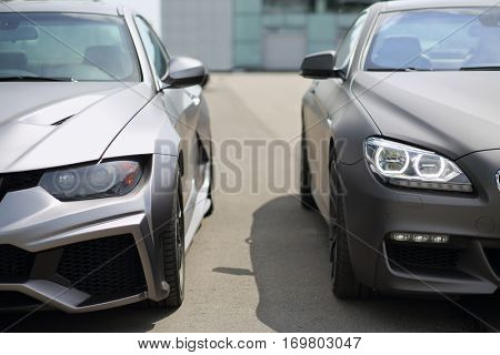 MOSCOW - JUN 19, 2016: Two sport model car BMW silver colored standing near the glass building