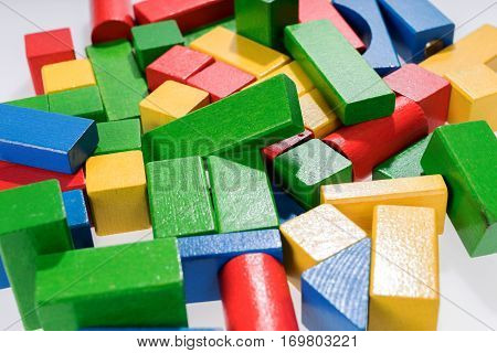 Toys blocks, multicolor wooden building bricks, heap of colorful game pieces