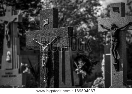 Tomb, Cemetery, details of crosses and tombs with sculptures of jesus christ and angels in spain