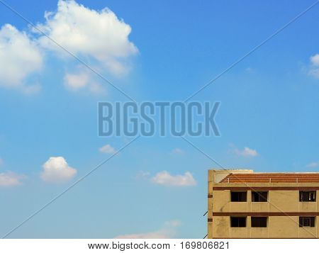 Highest floor of old apartment building with cloud and sky space for text