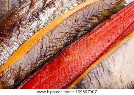 Smoked fish - red salmon halibut flounder. Food background.