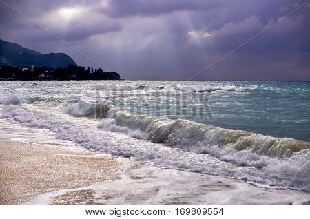 glimpse of the sun on the eve of the storm Indian ocean with waves