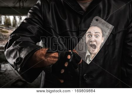 Serial maniac standing under bridge with knife.
