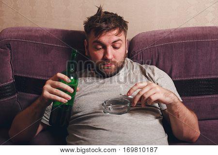 Alcohol addicted man smoke cigarette