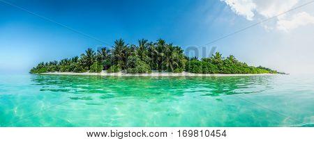Blue coral sea and island pano rama