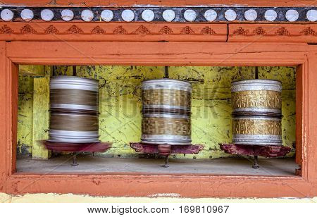Buddhist praying wheels at a monastery in Ladakh, Kashmir, India