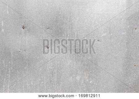 old galvanized steel plate background with rivet - metallic corrugated chrome texture