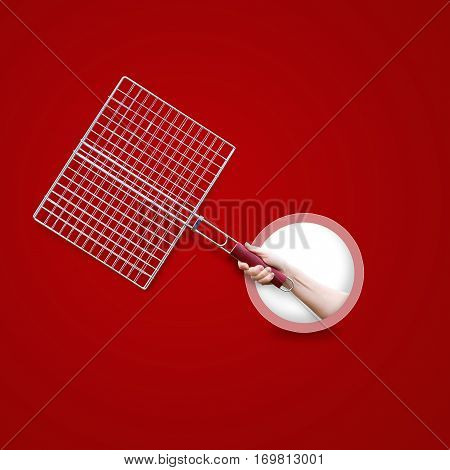 Steel Grid For Grill In Hand Isolated On A Red Background.