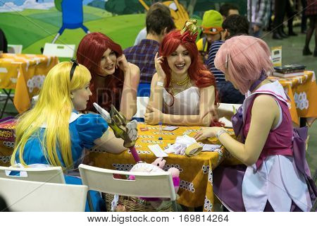 Moscow, Russia - November 19, 2016: Cosplayers playing table game at the Gamefilmexpo festival dedicated to video games, TV series and comics, anime, manga, cosplay.