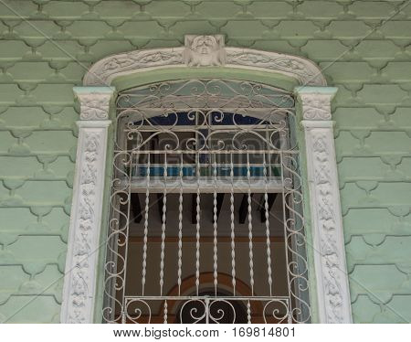 Cuban old colonial architecture: detail of elaborated wall and window in house. Cuba is famous for the vintage houses which attract tourists attention.