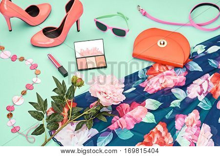 Fashion Design Spring girl clothes set, accessories, cosmetic. Trendy sunglasses, floral dress fashion handbag clutch.Glamor shoes heels, spring flower. Summer lady. Creative urban. Perspective view