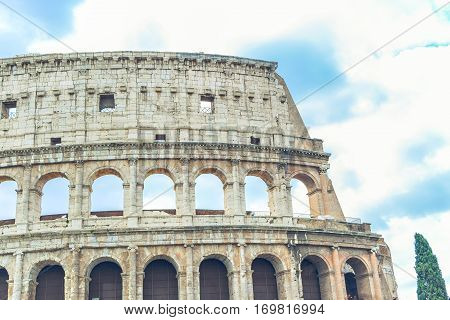 Stock Photo Coliseum made outside with clouds in the background