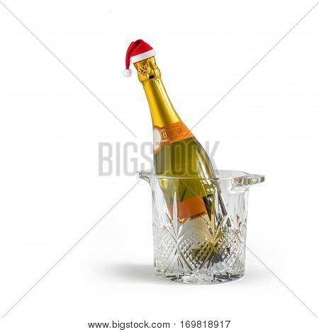 Champagne bottle in a bucket in the cap of Santa Claus