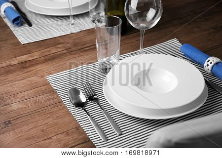 Elegant table appointments with blue napkin