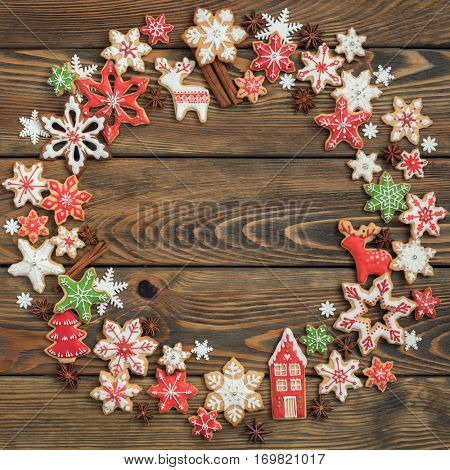 Gingerbread cookies on wooden background. Christmas wreath.