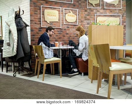 Moscow Russia - February 09 2017: Interior and visitors of a modern fast food cafe in the city center. PRIME cafe new russian brand of fast food in fast casual segment offers healthy natural food.