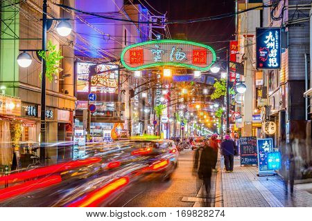 HIROSHIMA, DECEMBER 5, 2012 - Traffic passes through the Nagarekawa district of Hiroshima at night. The area is the main nightlife district of the city.