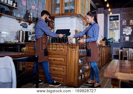 The bartender waiter working together in a bar  workplace.